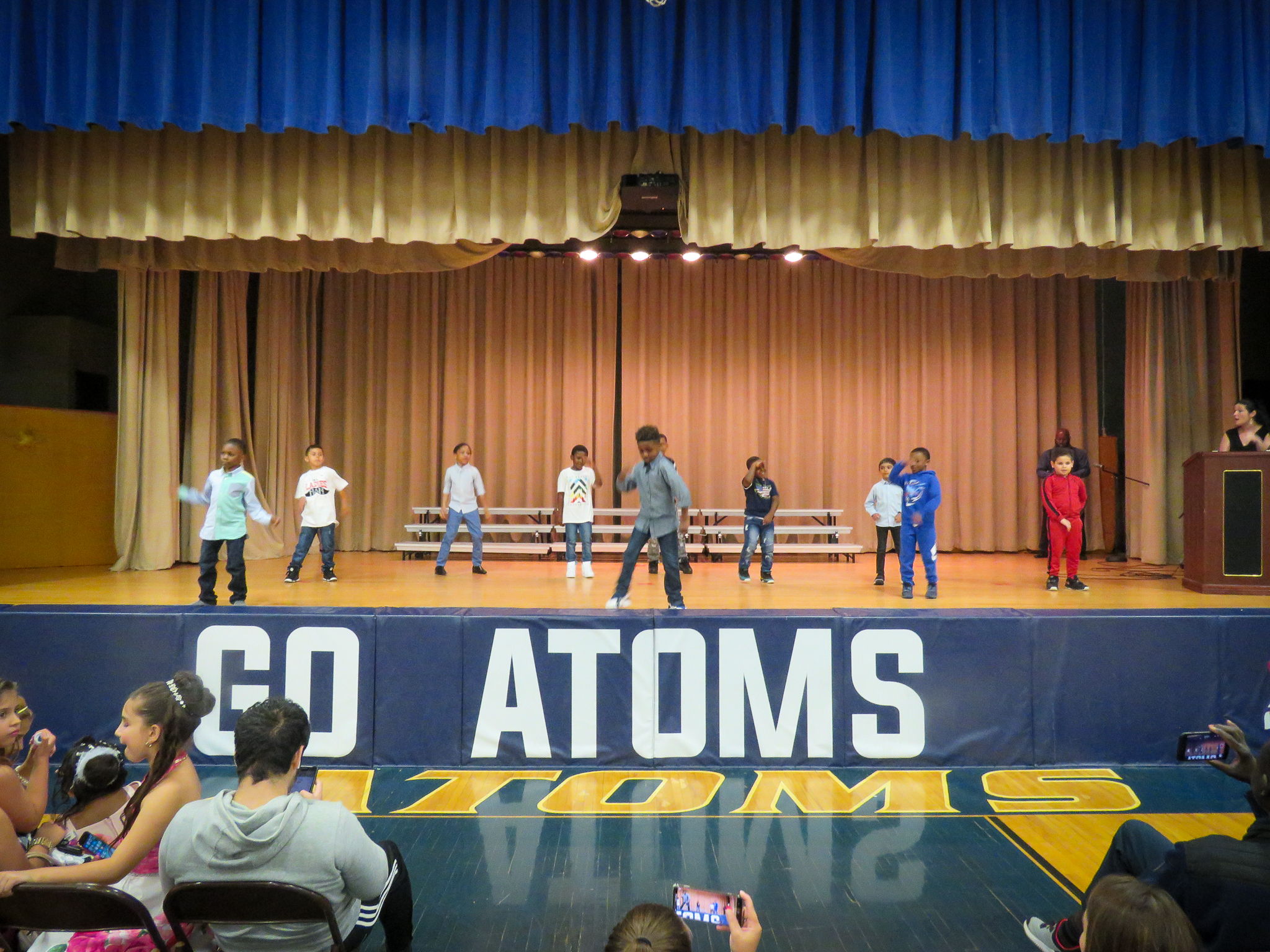 Atoms perform singing and dancing routines during their spring concert and talent show