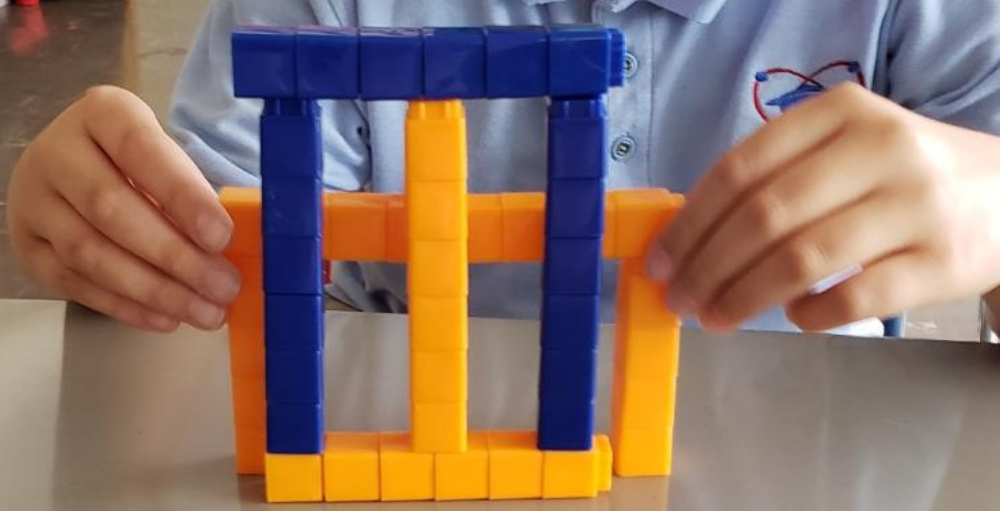The Syracuse Academy of Science and Citizenship 4th grade students in Mrs. Hebbert's class put their creativity to the test when creating a symmetrical design using math manipulatives.